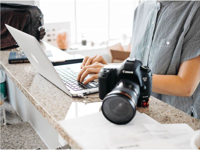 person at a laptop working as a photographer