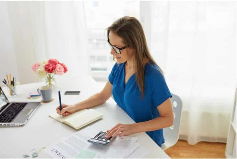woman at a desk working as a bookkeeper from home