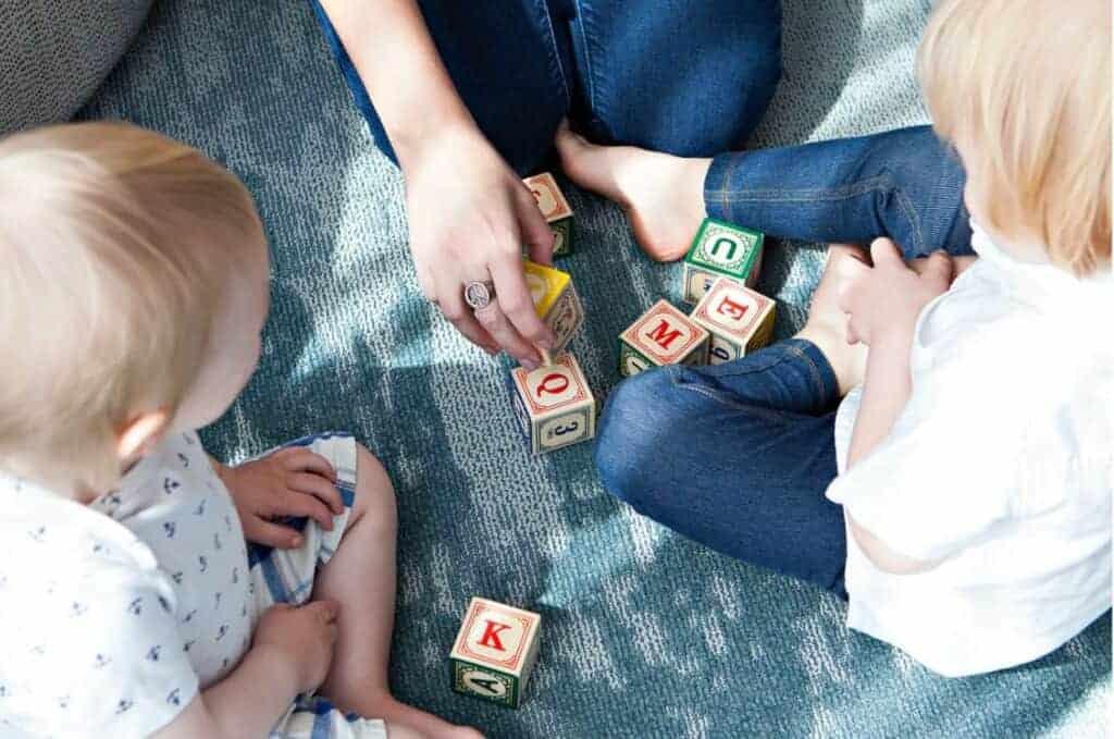 woman babysitting two children